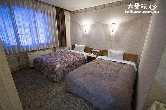 層雲閣格蘭飯店和洋室的床